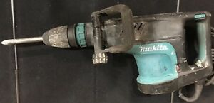 Makita Hm1203c 14 Amp 1 3 4 In Corded Variable Speed 20 Lb Demolition Hammer