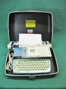 Turquoise Smith corona Coronet Automatic 12 Electric Typewriter Artisitic Font