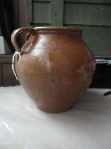 Primitive Redware Charming 7 H Ovoid Jug W Reddish Glaze And Dual Handles