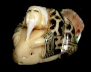 Japanese Ivory Colored Bone Netsuke Longevity Man White Beard Rides Whale Fish