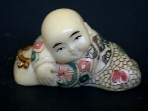 Japanese Ivory Colored Bone Netsuke Chinese Boy Sleeps On Fancy Pillow