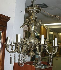 Antique Brass French Baroque Figural 9 Arm Chandelier With Pendalogue Crystals
