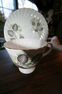 White Tan And Gray Cup And Saucer Mayfair England Bone China Gold Rim Different
