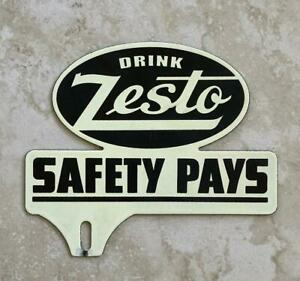 Drink Zesto Drive Safely Vintage Automotive License Plate Tag Topper Original