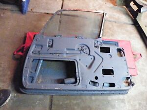 1957 Thunderbird Driver Side Door Complete With Glass And Power Window Lift Assy