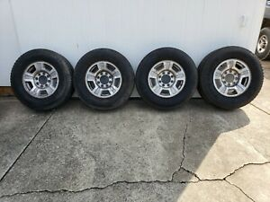Set Of Four 265 70 17 Tires Mounted On Chevy Oem Aluminum Rims
