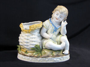 Antique Porcelain Figure Of A Child Little Boy With Basket Piano Baby