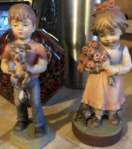 A Pair Of Wooden Carvings A Boy And Girl W Pets