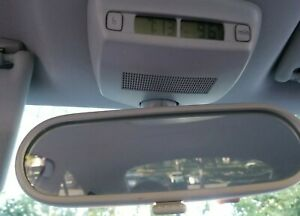 Interior Rear View Mirror With Clock From A 2010 Volkswagen Beetle Hatchback