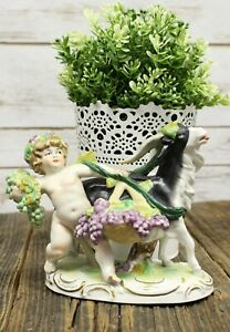 Scheibe Alsbach Porcelain Figure Of Putti Cherub With Goat And Grape Harvest