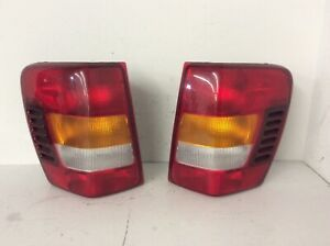 1999 2004 Jeep Grand Cherokee Tail Lights Left Right Set 99 00 01 02 03 04 Oem