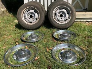 Gm Rally Wheels With Caps And Trim Rings set Of 4