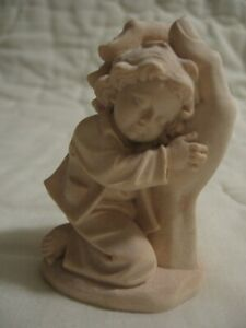 Detailed Wood Carving Of A Boy In A Hand Figurine Wooden