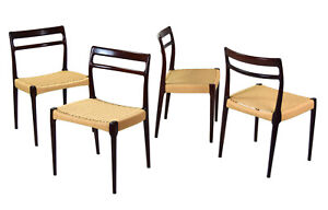 Set Of Four Vintage Danish Modern Rosewood Dining Chairs With Cord Seats