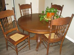 4 Antique Pressed High Back Dinning Chairs With Cane Seats And Hardwood Table