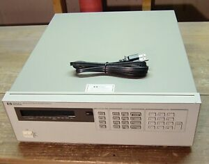 Hp Agilent 6624a Quad Variable Dc Output Power Supply For Parts Or Repair