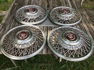 Vintage Set Of 4 Oem 80s Cadillac Deville Fleetwood Eldorado Wire Spoke Hubcaps