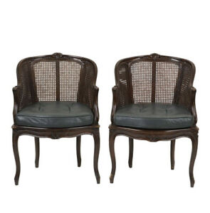 Early 20th Century Louis Xv Style Beechwood And Cane Paneled Bergeres A Pair