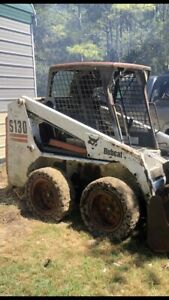 Bobcat Skid Steer S130 smokes
