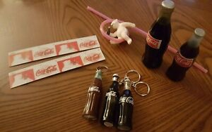 coca cola lot-8 items-2 rulers 2 knick knacks bottles  1 straw  3 keychains