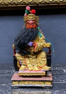 A Carved Figure Of Guan Yu Sitting On The Throne