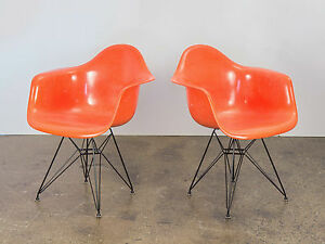 Pair Of Orange Eames Armchair Shells For Herman Miller On Black Eiffel Base