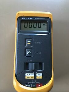 Fluke 10 Digital Multimeter And Yellow Rubber Protective Cover