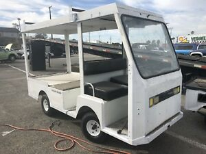 Used Taylor Dunn B2 48 Industrial Flatbed Electric Utility Cart With Top
