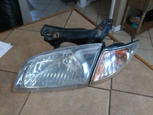 2000 2002 Chevrolet Cavalier Left Driver Side Headlight And Marker Light Set