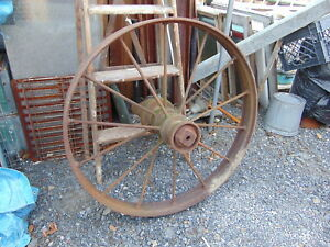 1 Antique Primitive Country Farm Cast Iron Metal Wagon Wheel 34 Around X 4