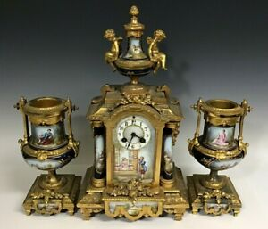 Three Piece Porcelain Clock And Garniture