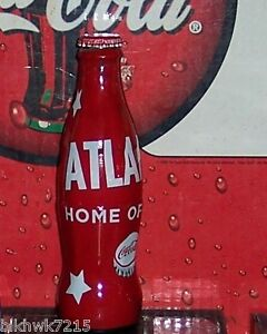2014 WORLD OF COCA COLA  ATLANTA HOME OF COKE WRAPPED 8 OZ COCA COLA BOTTLE NEW