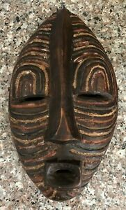 A Painted Chip Hand Carved Wooden African Songye Mask