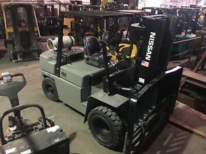 Nissan 10000 Lb Solid Pneumatic Forklift With Triple Mast And Dual Drives