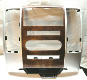 2009 2012 Dodge Ram Center Dash Oem Woodgrain Silver Radio Bezel Surround