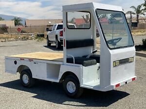 Used Taylor Dunn Burden Carrier Industrial Flatbed Gas Powered Utility Cart