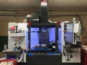 Haas Vf 2 Vmc 8100 Rpm 24 Atc Auger And Haas Hrt A 6 Rotary Table