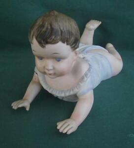 Bisque Porcelain Baby Piano Figurine Boy Crawling Blue Eyes Brown Hair