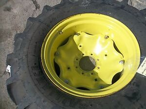 Two 14 9x24 Two 7x16 1050 John Deere Tractor Tires W all On Wheels