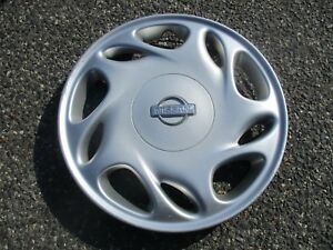 One Genuine Factory 1996 To 1997 Nissan Altima Hubcap Wheel Cover