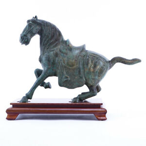 Chinese Tang Dynasty Style Patinated Bronze Model Of A Horse