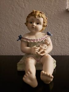 Antique German Bisque Porcelain Piano Baby Girl Holding A Doll