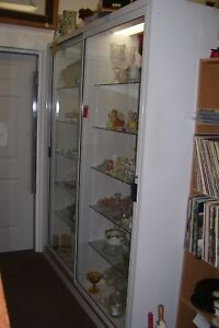 Large Display Case W two Sliding Doors And 6 adjustable Glass Shelves lights