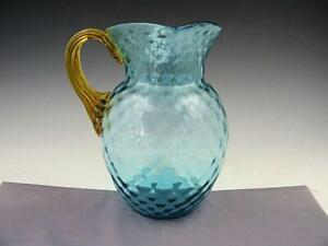 Victorian Blue Glass Water Pitcher With Applied Reeded Amber Glass Handle