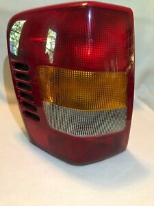 99 02 Jeep Grand Cherokee Driver Side Tail Light 55155139ac 144067