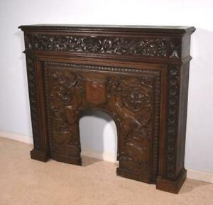 Antique French Gothic Revival Oak Fireplace Surround Mantel With A Bronze Insert