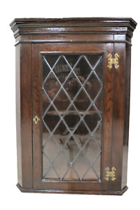 Antique English Oak Hanging Wall Mount Hanging Corner Cabinet With Lead Glass