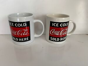 Two 3 1/2 Inch Vintage Coca Cola Mugs/ Cups One White  One Cream Color.