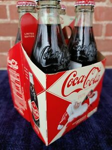 Coca Cola 4 pac- 2012 Holiday Christmas Bottles - Unopened & Full - Coke