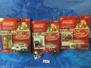 Lot of (3) 2004 Coca-Cola Johnny Lightning diecast vintage collector cars(#707)